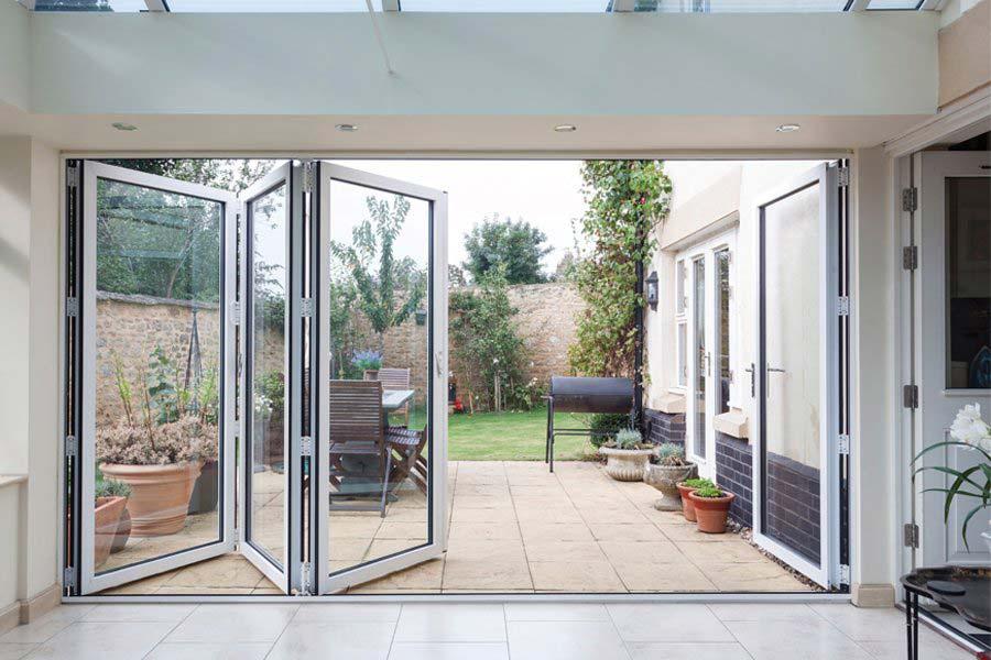 white aluminium multi folding doors opening up to a garden