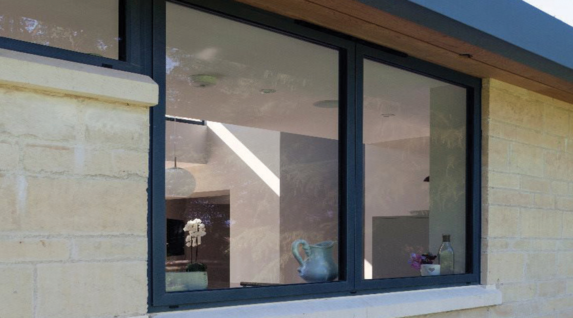 application shot of a grey aluminium casement window on the outside of a home