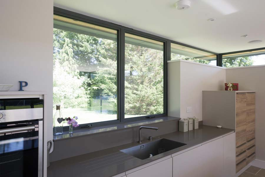 grey aluminium casement windows in a modern kitchen