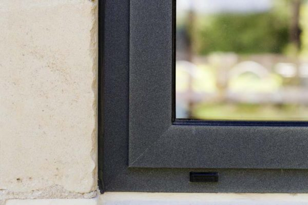close up of grey aluminium casement windows