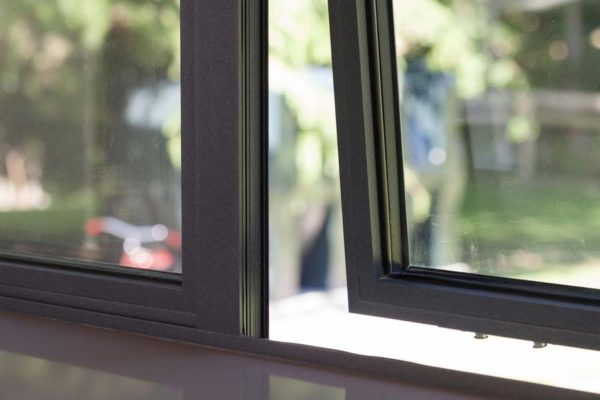 close up of grey casement windows opening