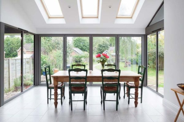 light grey bi-folding doors in a domestic dining room environment