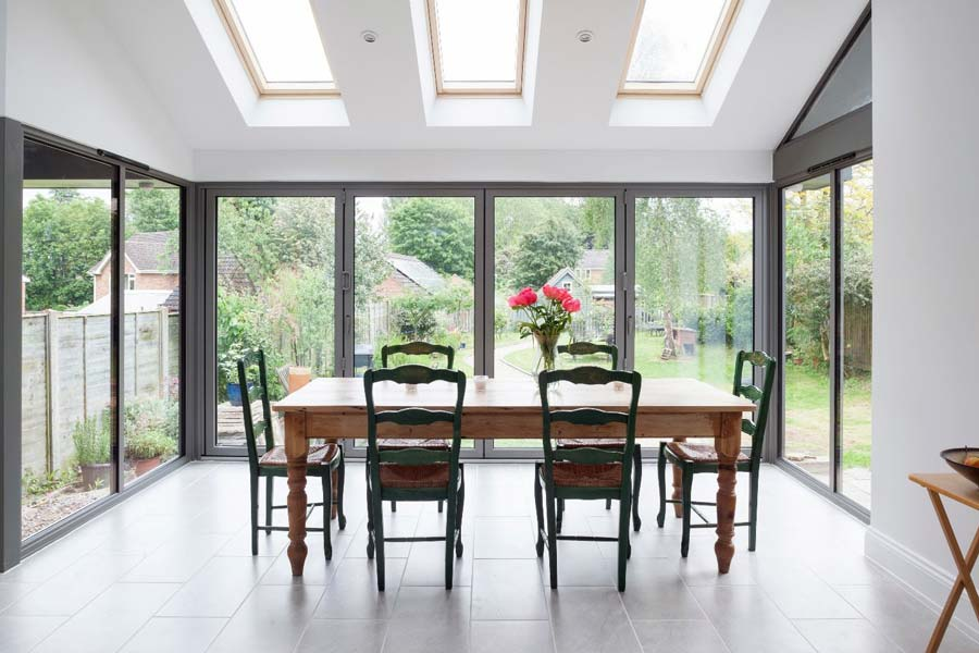 light grey bi-folding doors in a domestic dining room environment