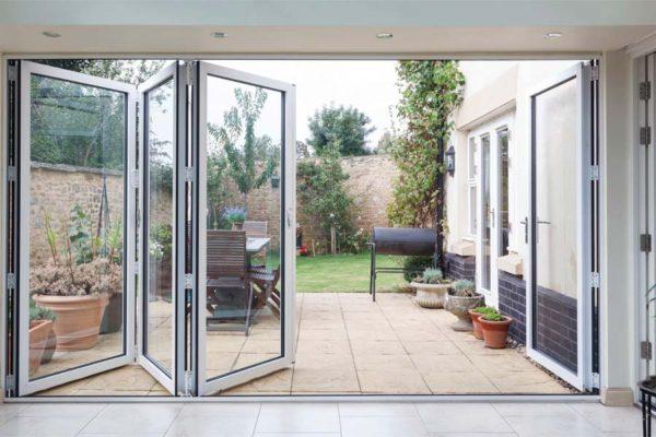 white aluminium bifolding doors opening into a garden
