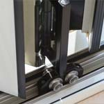 example of stainless steel wheels on aluminium doors