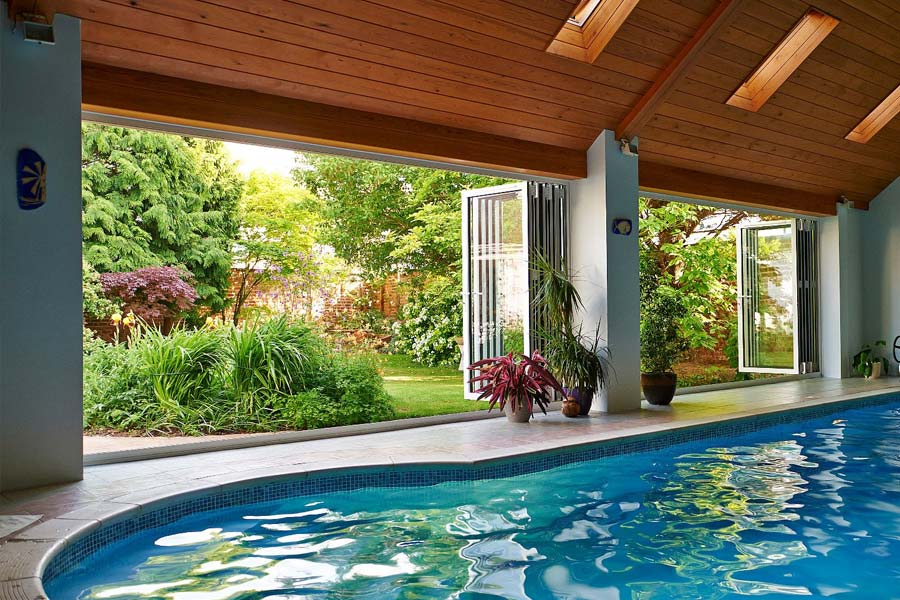 smarts visofold 1000 doors opening up a swimming pool area into a large garden