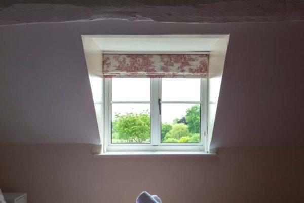 small white heritage window in a bedroom