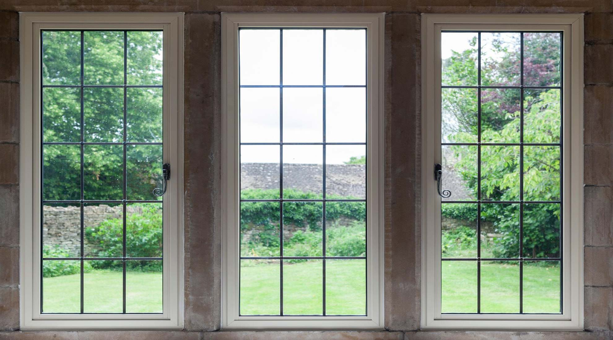 cream heritage windows outlooking the garden