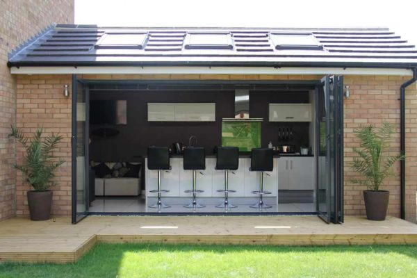 Black Sf55 exterior shot leading from garden into kitchen area