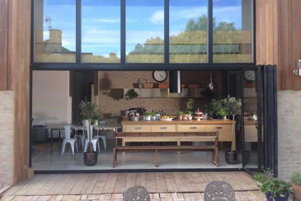 Open Black Sf55 Bi-folding Doors leading into kitchen area