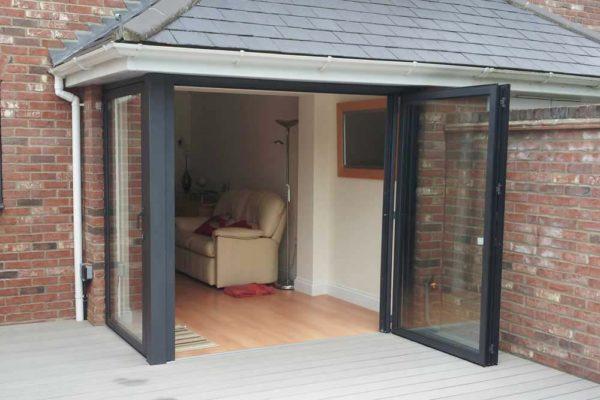 Black Sf55 exterior shot leading from garden into living room