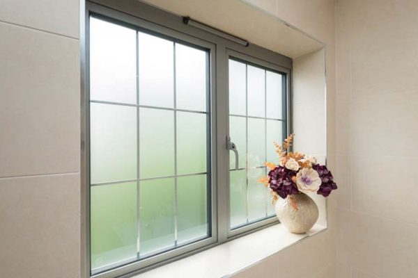 OW 70 Aluminium Casment window in grey with frosted glass