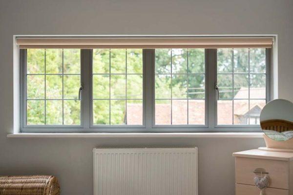 OW 70 Aluminium Casement window in grey with roller blind