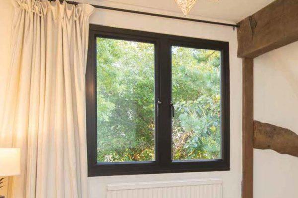 Black OW-80 Aluminium Casement Window in neutral coloured room