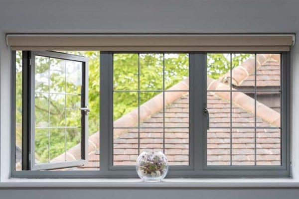 OW 70 Slimline Aliminium Casement window in grey with window open