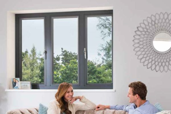 couple sitting in front of a Grey OW-80 Aluminium Casement Window