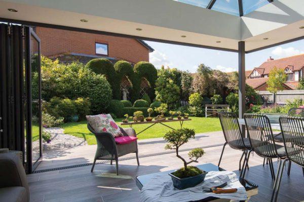 Large conservatory view of summer garden ob 49 origin door open Origin Sussex