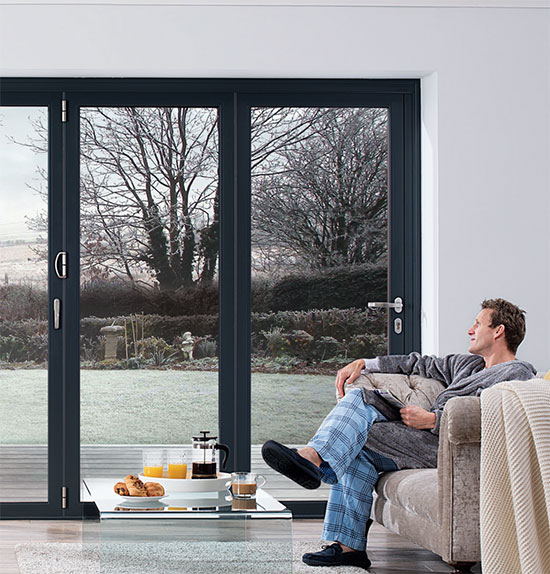 OB 49 doors with man sitting looking out onto winter garden